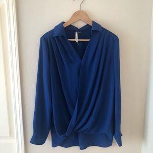 Blue bellatrix blouse. Size large.